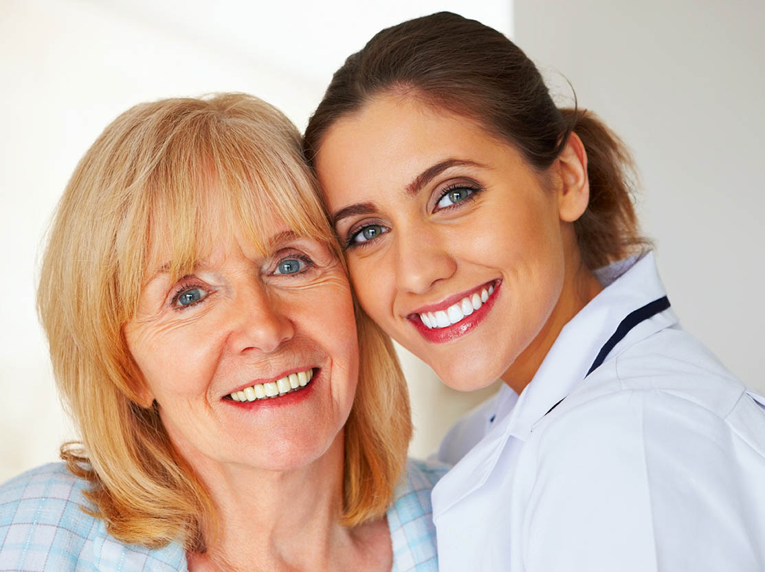 Healthcare professional with healthy senior lady